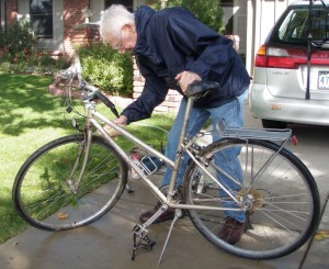 Dad cleaning bike